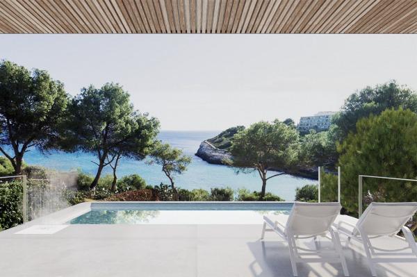 Einzigartige Neubauvilla in erster Meereslinie in Cala Mandia
